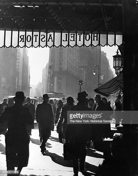 Crowds along Broadway seen from the entrance to the Hotel Astor between 44th and 45th Streets looking south 1930's New York New York 1920s