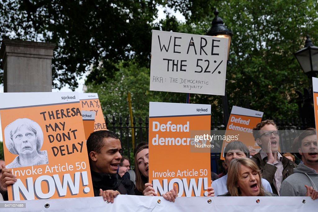 Crowds and protests around Downing street on 13 July 2016 in London, UKas David Cameron leaves office for the last time and the new Prime Minister Theresa May enters Donning street. Protests included those who where against Conservative party budget cuts and also those calling for article 50 of the Lisbon treaty to be invoked immediately