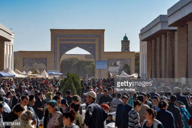 Crowds and tourists near the western gate of Khiva, Uzbekistan