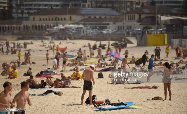 Crowds are seen on Bondi Beach ahead of its closure in Sydney on March 21 2020 Authorities temporarily closed Bondi Beach on March 21 after huge...