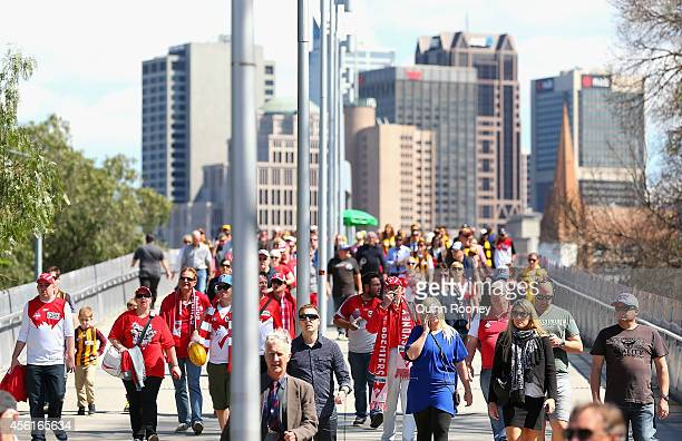 Crowds arrive for the 2014 AFL Grand Final match between the Sydney Swans and the Hawthorn Hawks at Melbourne Cricket Ground on September 27 2014 in...