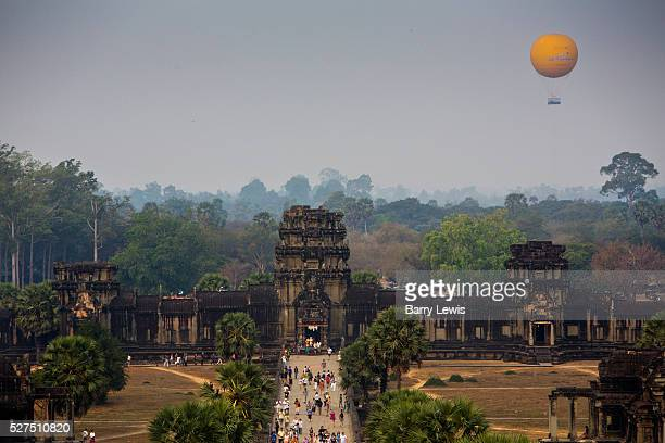 Crowds arriving at dawn in Angkor Wat with Angkor Wat Balloon in distance The balloon is 1k west of the Angkor WatThe German made helium balloon is...