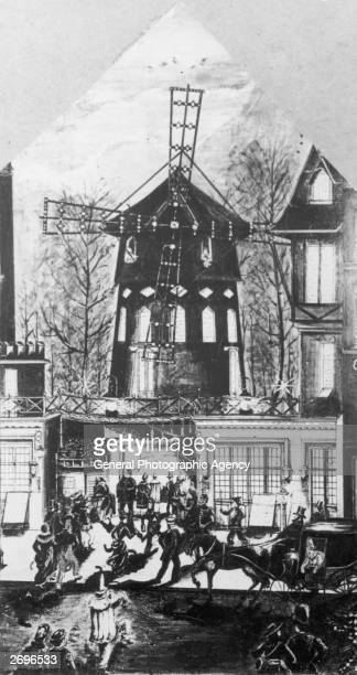 Crowds arriving at the Moulin Rouge music hall and cabaret venue in a converted windmill in the Montmartre district of Paris