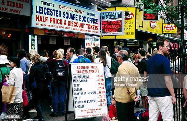 crowds at a box office in leicester square - london,greater london, england - theatrical performance stock pictures, royalty-free photos & images