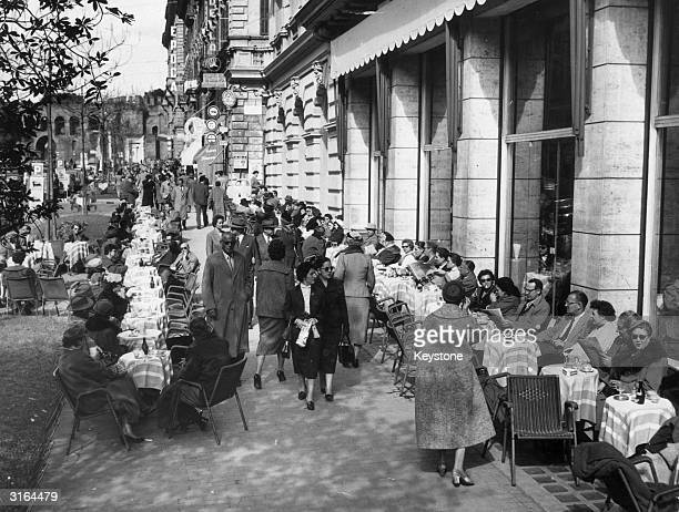 Crowds at a street cafe in Rome