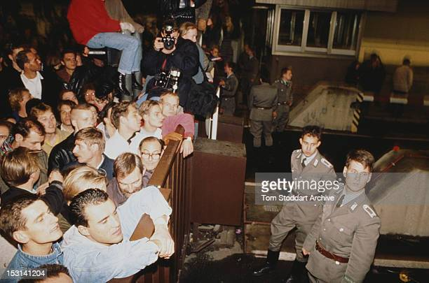 Crowds at Checkpoint Charlie on the Berlin Wall on the night the crossing point between East and West Berlin opened 9th November 1989