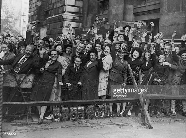 Crowds at Downing Street, London, cheer prime minister Clement Attlee after the surrender of Japan.
