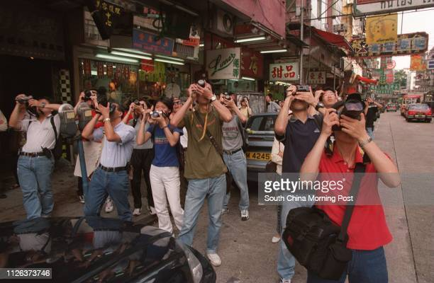 Crowds at Kowloon City taking pictures of the airplanes landing at Kai Tak airport in the last hours of the airport 4 jul 98