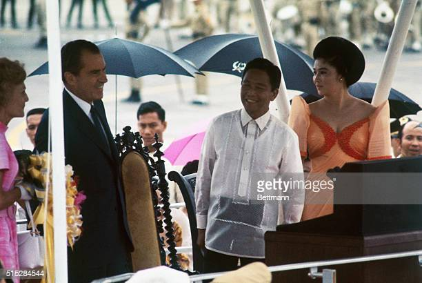 Crowds at Manila Airport welcome President Richard Nixon and Mrs Nixon upon their arrival July 26th Greeting them were President Ferdinand Marcos of...