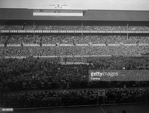 Crowds at the Tottenham Hotspur Football Club ground White Hart Lane in North London watching a boxing match