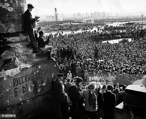 Crowds attend a mass meeting called by socialist parties to counter meetings held by the communists in Berlin