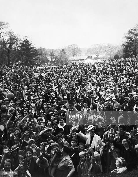 Crowds attend the traditional White House Easter Egg Roll on the South Lawn of the White House in Washington, DC, circa 1935.