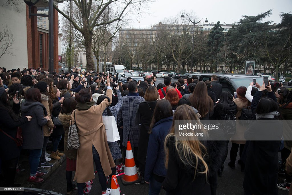 Crowds await a celebrity outside the Dior Homme show at Tennis club de Paris on January 23, 2016 in Paris, France.