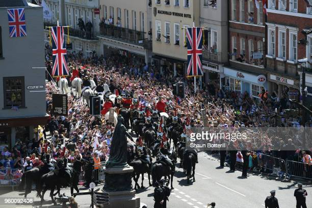 Crowds await as Prince Harry, Duke of Sussex and Meghan, Duchess of Sussex leave Windsor Castle in the Ascot Landau carriage during a procession...