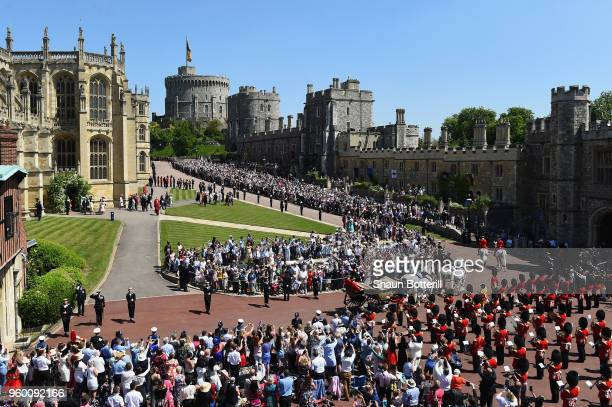 Crowds await the wedding of Prince Harry to Ms Meghan Markle at St George's Chapel, Windsor Castle on May 19, 2018 in Windsor, England. Prince Henry...