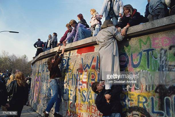 Crowds bear witness to the Fall of the Berlin Wall 10th November 1989 They are on a section of the wall near the Brandenburg Gate a high profile...