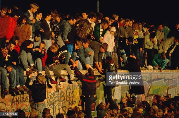 Crowds bear witness to the Fall of the Berlin Wall November 1989 This is a section of the wall near the Brandenburg Gate – a high profile location...
