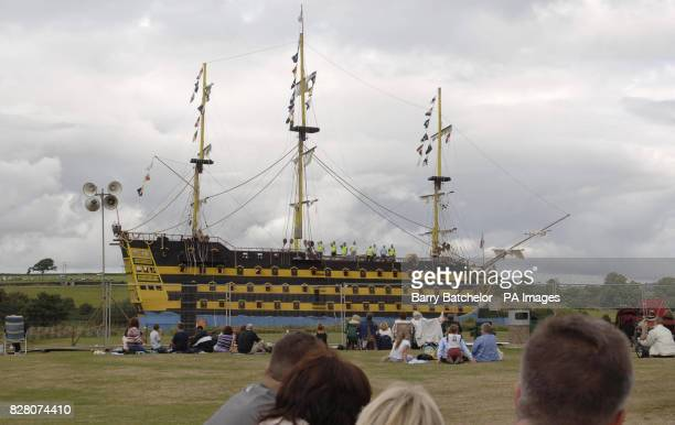 Crowds begin to gather a few hours before the lighting of the bonfire that will destroy the replica of Nelson's flagship HMS Victory at Torrington...