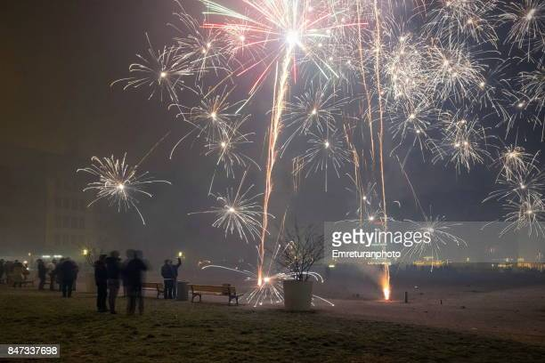 crowds celebrating new year with fireworks at marienhof in munich.creativecontentbrief. - emreturanphoto stock pictures, royalty-free photos & images