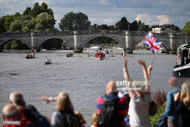 Crowds cheer as crews compete in the annual 'Great River Race' a 22 mile rowing race on the River Thames from the Docklands to Richmond on September...