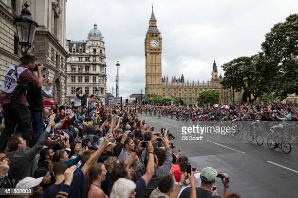 Crowds cheer as cyclists competing in the Tour de France pass through Parliament Square at the end of the race's third stage on July 7 2014 in London...