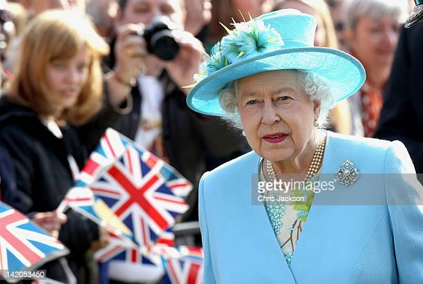 Crowds cheer as Queen Elizabeth II arrives in Valentine's Park Redbridge as part of her Diamond Jubilee tour of the UK on March 29 2012 in London...