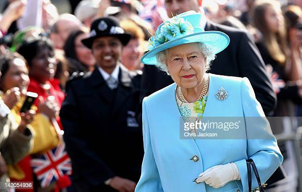 Crowds cheer as Queen Elizabeth II arrives in Valentine's Park Redbridge as part of her Diamond Jubilee tour of the UK on March 29, 2012 in London,...