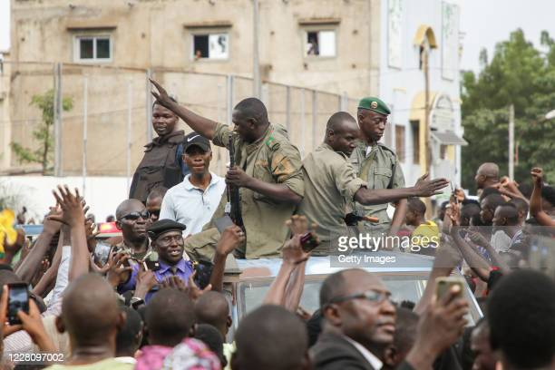 Crowds cheer as soldiers parade in vehicles along the Boulevard de l'Independance on August 18 2020 in Bamako Mali President Ibrahim Boubacar Keita...