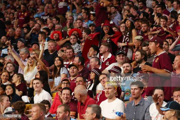 Crowds cheer during game three of the State of Origin series between the Queensland Maroons and the New South Wales Blues at Suncorp Stadium on...