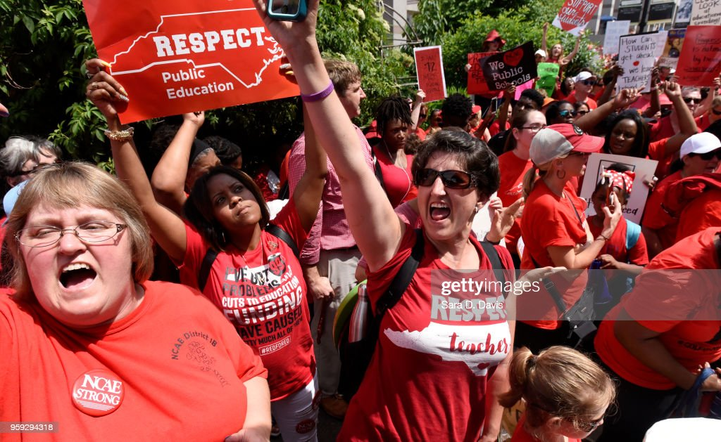 Crowds cheer during the Rally for Respect outside the North Carolina Legislative Building on May 16, 2018 in Raleigh, North Carolina. Several North Carolina counties closed schools to allow teachers to march on the opening day of the General Assembly.
