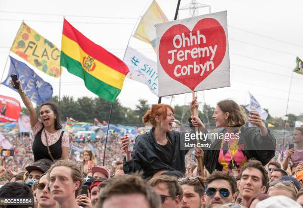 Crowds cheer Labour Party leader Jeremy Corbyn address the crowd from the main stage a the Glastonbury Festival site at Worthy Farm in Pilton on June...