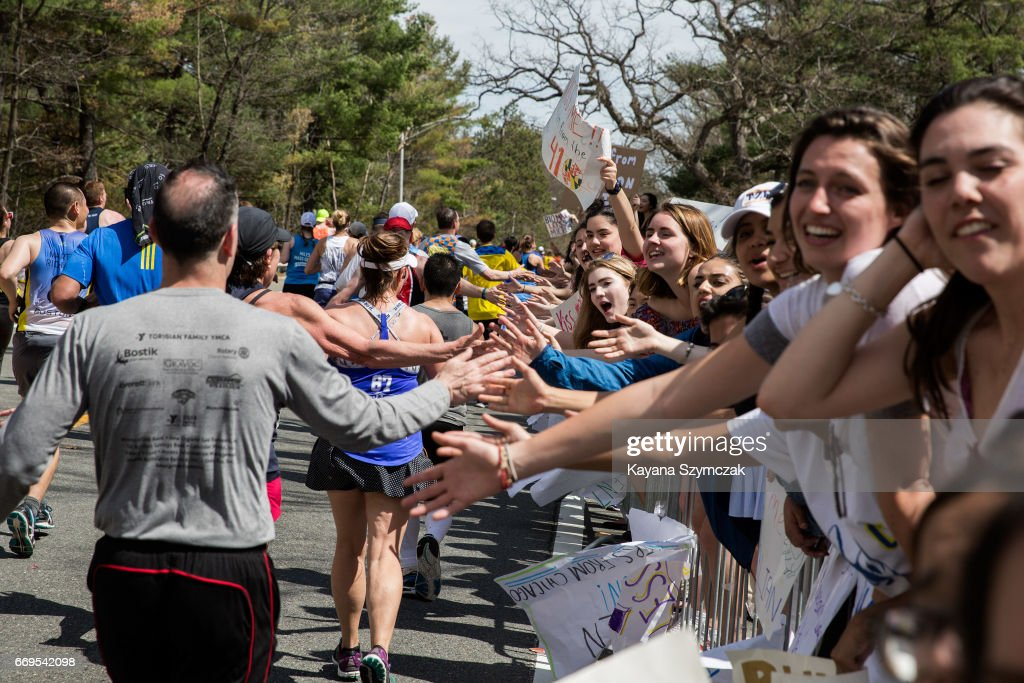 Crowds Gather Along Route of Boston Marathon To Cheer On Runners : News Photo