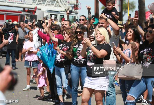 Crowds cheer on Heavyweight boxing champion Andy Ruiz Jr during a homecoming parade on June 22 2019 in Imperial California Boxer Andy Ruiz upended...