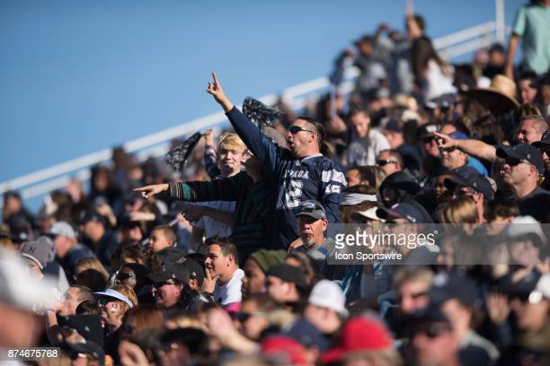 Crowds cheer on the wolf pack during the college football game between the San Jose State Spartans and the Nevada Wolf Pack on November 11 2017 at...
