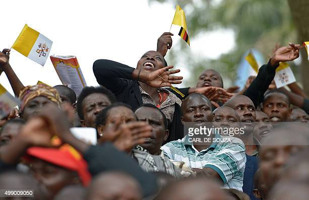 Crowds cheer Pope Francis as he arrives at Namugongo Martyrs' Shrine before holding mass on November 28 2015 Pope Francis arrived in Uganda on...