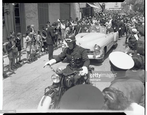 Crowds Cheer Rita and Aly after Ceremony Vallauris France Preceeded by motorcyle police escort screen actress Rita Hayworth and her new husband...