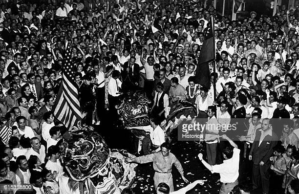 Crowds cheer wildly in New York City's China Town after they heard the announcement of Japan's unconditional surrender August 15 1945 | Location...