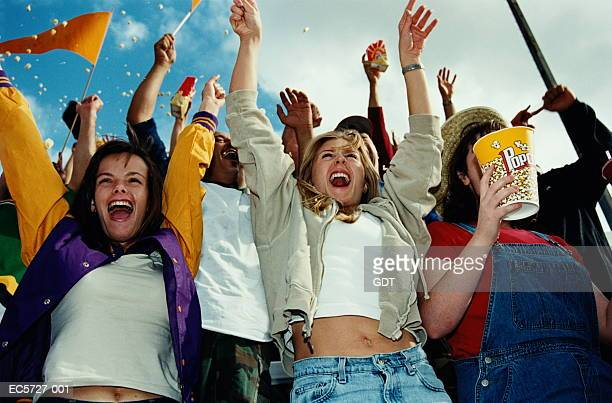 crowds cheering at sporting event, women with arms raised - crowd cheering stock pictures, royalty-free photos & images
