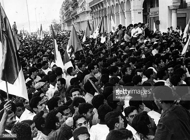 Crowds cheering Ben Khedda premier of the provisional government of the newly independent Algeria outside the prefecture in Algiers