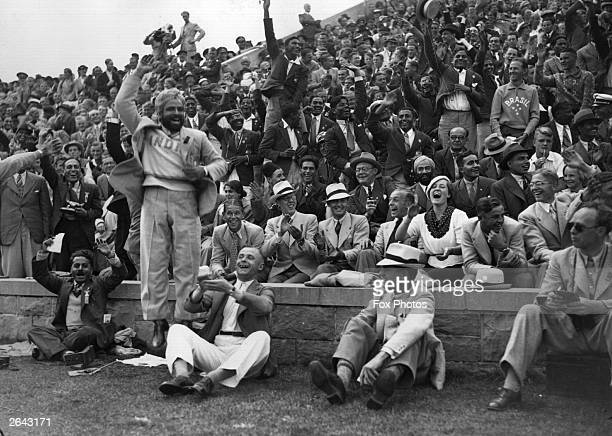 Crowds cheering the athletics events at the 1936 Berlin Olympics