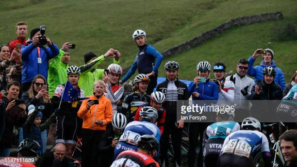 Crowds cheers riders as they climb the Cote de Park Rash ascent near the village of Kettlewell in the Yorkshire Dales during the fourth and final...
