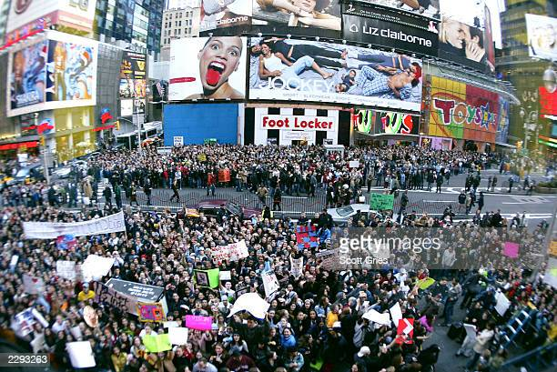 Crowds clog the streets bringing traffic to a halt in Times Square with hopes of getting a glimpse of Eminem during his appearence on TRL at the MTV...