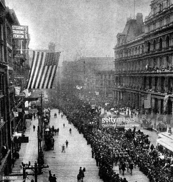 Crowds come out to show their support during a parade sending off American troops to fight in the SpanishAmerican War of 1898 Cincinnati Ohio