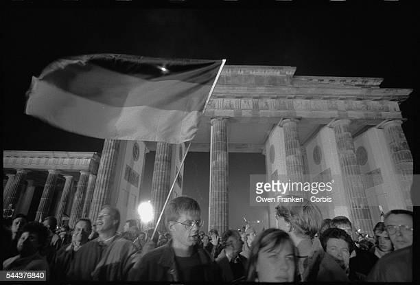 Crowds converge on the Brandenburg Gate at midnight October 23 the moment that the official reunification of East and West Germany took effect Access...