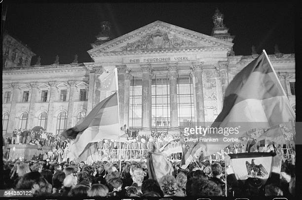 Crowds converge on the Reichstag the past and future seat of the German Parliament at midnight on October 23 the moment that the official...