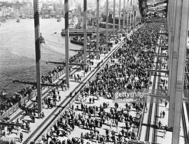 Crowds crossing Sydney Harbour Bridge for the opening celebration 19th March 1932