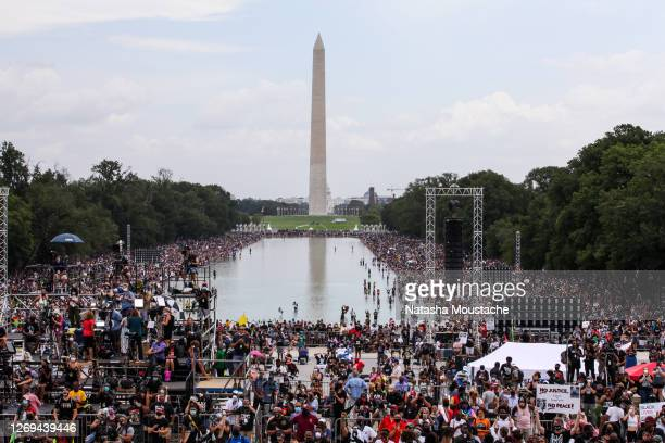 Crowds descend upon the National Mall during the Commitment March at the Lincoln Memorial on August 28, 2020 in Washington, DC. Rev. Al Sharpton and...