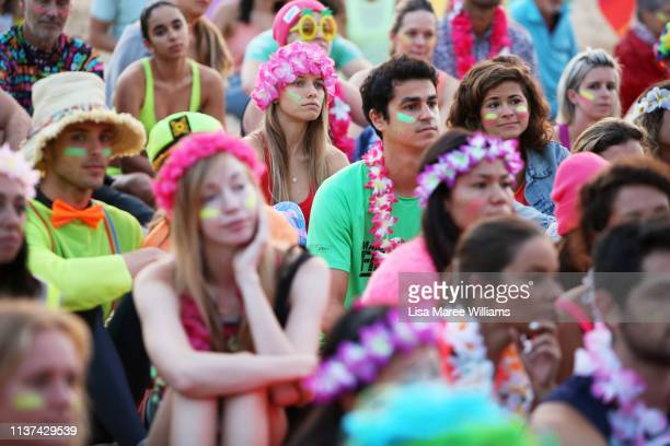 Crowds dress in bright colours in solidarity with OneWave at sunrise on Bondi Beach on March 22 2019 in Sydney Australia Surfers gather to celebrate...