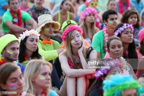 Crowds dress in colour in solidarity with OneWave at sunrise on Bondi Beach on March 22 2019 in Sydney Australia Surfers gather to celebrate five...