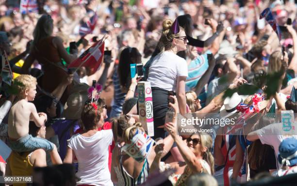 Crowds during the wedding of Prince Harry to Ms. Meghan Markle at St George's Chapel, Windsor Castle on May 19, 2018 in Windsor, England. Prince...